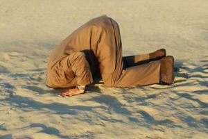 в песок